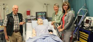 Colin and Lois Pritchard and their daughter Alison Moscrop check out the 'SimMan 3G' patient simulator, now located in the Pritchard Simulation Centre at the Clinical Academic Campus.