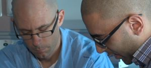 Dr. Trent Smith (left) working alongside third-year student Kulveer Parhar (Credit: CFJC TV)