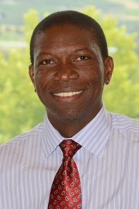 Dr. Oyedele